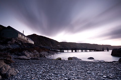 Tackle house and Jetty, Lundy Island, UK (jogorman) Tags: uk longexposure sunset england house southwest beach water night island coast harbor twilight nikon waves unitedkingdom harbour dusk cove jetty tide tripod sigma wave pebbles landing explore coastal devon filter shore nd 1020mm filters grad 1020 isle tidal lundy tackle graduated devonshire bristolchannel cokin p121 neutraldensity explored celticsea msoldenburg p121s d3x