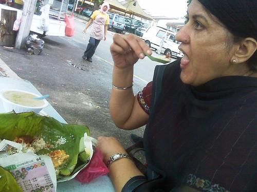 Mom enjoying nasi lemak ;)