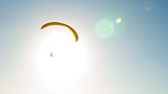 off we go, into the wild blue yonder (Ben McLeod) Tags: california sun lens lajolla lensflare flare 1755mmf28g paragliding sunflare afsdxzoomnikkor1755mmf28gifed torreypinesinternationalgliderport