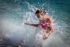 Splash (Ugo Cei) Tags: sea water girl nikon bath waves foam splash swimsuit 2009 d60 nikond60 dslrdad nikkor35mm18afs