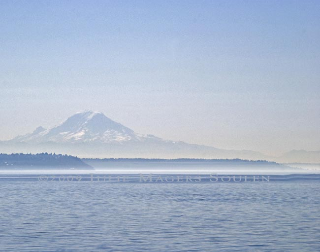a photograph of a misty foggy day at Mount Rainier and Elliott Bay in Seattle