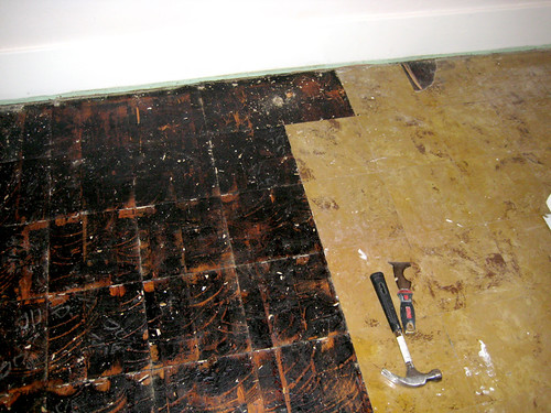 bedroom floor while prying up tiles