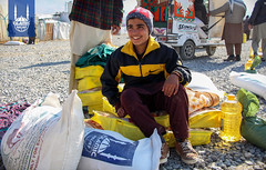Islamic Relief staff distribute food items for winterization program in Afghanistan