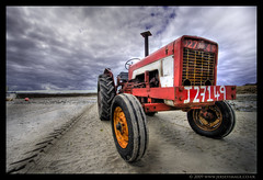 J27149 the Red Tractor (jerseyimage) Tags: old tractor color colour beach horizontal outside outdoors sand day diesel cloudy rusty overcast august jersey 2009 hdr channelislands redandwhite 434 tyremarks stouen redtractor vintagetractor letacq jerseyimage jnumber j27149 internationalmccormick