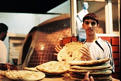 Memories of Hajj 1429H : The Bread Series : The Baker I (W  M Soo) Tags: food film shop analog bread oven muslim islam middleeast bakery arabian nan haji mecca umrah roti mekah makkah hajj ksa chickencurry nikonfm muttoncurry nikkor50mmf18d kingdomofsaudiarabia wansoo negativescanned wmsoo memoriesofhajj1429h kuahdhal rotitempayan