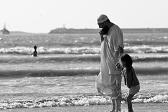 Father and daughter (dani.Co) Tags: ocean africa summer white holiday black beach childhood sand nikon waves wind father daughter atlantic explore morocco essaouira d300 baistas banhistas explored danico