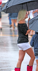 Rainy Day Blonde (wyojones) Tags: woman girl rain texas czech boots young blond blonde umbrellas wellies rubberboots caldwell rainboots kolache caldwelltexas kolachefestival czechheritage wyojones czechsettlements