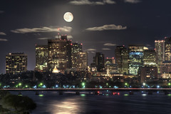 Moon over Boston (Werner Kunz) Tags: world city longexposure trip travel cambridge sea vacation urban usa moon lake holiday reflection building tower water boston skyline night clouds speed america photoshop river ma rising lights town us nikon long exposure downtown time massachusetts charlesriver north newengland wideangle center spot explore stadt northamerica 100 40 priority frontpage dri opticalillusion hdr hdri werner beantown metropole shutterspeed artificiallight skyscrapper kunz photomatix badmoon 20fav explored colorefex nikond90 topazadjust werkunz1