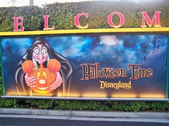 HalloweenTime billboards at the Mickey & Friends Tramp Stop (Loren Javier) Tags: halloween disneyland snowwhiteandthesevendwarfs wickedwitch disneyvillains wickedqueen halloweentime disneylandtram mickeyfriendsparkinglot
