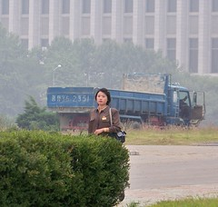 Woman walking to Work in Pyongyang North Korea (Ray Cunningham) Tags: woman tourism del work north korea tourist american norte northkorea pyongyang corea dprk koryo 平壤 北朝鮮 корея 평양 조선민주주의인민공화국 raycunningham zaruka raymondkcunninghamjr ©raymondkcunninghamjr northkoreanphotography raycunninghamnorthkoreanphotography dprkphotography