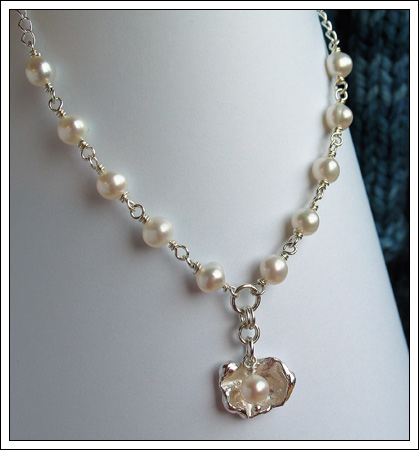 Pearl necklace with a water cast silver pendant