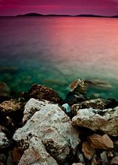 Island from Shore ~ Explored ~ (Sergiu Bacioiu) Tags: park pink blue sunset sea summer sky color nature water beautiful rock stone night clouds landscape island coast scenery rocks view angle dusk space horizon shoreline scenic croatia wideangle nobody scene calm shore romantic coastline adriatic
