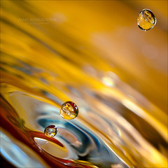 Goutte  goutte - This is it - 2/4 (Marc Benslahdine) Tags: macro water colors jaune drops raw bokeh magic levitation refraction bubble waterdrops 2012 lightroom timing flickraddict bordeau gouttedeau findumonde microworld canonef100mmf28macrousm arrtsurimage abigfave canoneos50d marcopix flickrbronzeaward flickrsilveraward carrfranais tripax marcbenslahdine wwwmarcopixcom wwwfacebookcommarcopix marcopixcom