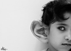 "listening is the key of wisdom (""Anwaar) Tags: baby white black art girl canon 50mm is kid big key graphic sister surreal talk manipulation more listening photograph ear daisy kuwait wisdom conceptual f18 less kuwaiti listen q8 dema 400d abigfave anwaar"