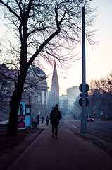 reminders (ewitsoe) Tags: walk man morning winter dawn city cityscape urban street erikwitsoe nikond80 35mm ewitsoe poznan poland wintery cold chill operahouse cathedral traffic buildings tree bare light