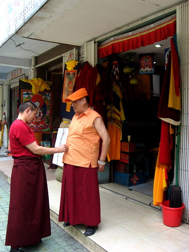 Tibetan monks grooming each other