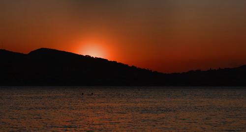 the sun sets at anavyssos
