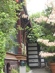 Nob Hill House (AGA~mum) Tags: awning spiderweb turret wateringcan carvings awnings paintedlady victorianhome ornategates latinphrase queenannehillseattle nobhillinseattle quoampliuseoamplius