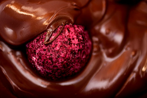 Red velvet cake ball swimming in chocolate