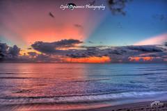 Sunrise 2009-09-07 (BeachsidePaul) Tags: ocean pink orange beach clouds sunrise unitedstates florida horizon atlantic oceanside watersedge oceanview atlanticocean oceanfront satellitebeach oceanscape horizonoverwater cloudsoverocean chiesman hightowerpark raysoverthehorizon