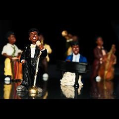 Singing Jazz (Salva Mira) Tags: music canon reflections eos 50mm bokeh jazz orchestra f18 50 msica bigband salva reflexes 50d strobist eos50d can
