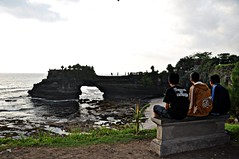 Temple by the sea - Tinah Lot (rosswebsdale) Tags: sunset sea bali cloud sun rock indonesia temple coast arch indo 2009 bintang tanahlot seminyak