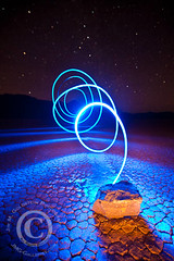 Racetrack Light Lasso (jimgoldstein) Tags: california light sky lightpainting rock night racetrack dark stars landscape spiral pattern desert dry playa lakebed deathvalley lit arid lightroom deathvalleynationalpark top20longexposure jmggalleries jimmgoldstein canon1dsmarkiii epiceditsselection