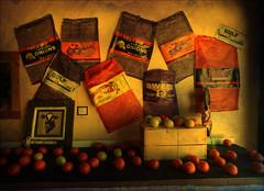 the produce display (purduebob) Tags: al gulf sony tomatoes alabama produce dslr a200 shores sacks 1118mm sonydslra200 purduebob powerwindowspro