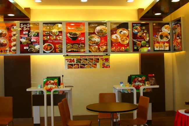 There are now only 2 cashier stations to service the whole store and above them is the more attractive and less-cluttered menu board.