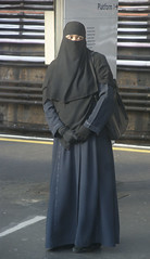 Waiting for her train, East London (ilovehijab) Tags: hijab gloves niqab abaya jilbab muslima