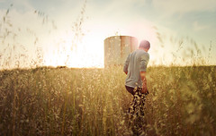As the day falls (isayx3) Tags: light portrait sun guy tower water field asian golden nikon glare natural 28mm aaron sigma hills flare f18 studios tones d3 plainjoe isayx3 plainjoephotoblogcom