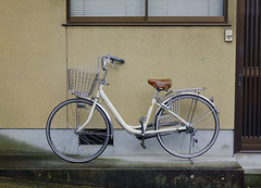 Bicycle at the house in Kyoto, Japan (phuong.sg@gmail.com) Tags: antique backgrounds basket bicycle black broken city color concrete copy cycle damaged day dirty horizontal house image italian leaning life mode nobody object obsolete old orange parking red retro revival scene single space stained stationary town transport travel tuscany urban vertical wall wheel yellow