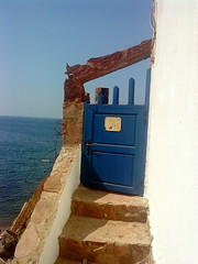 The Blue door - Beldj (intasko) Tags: ocean voyage door trip blue light sea mer color beach beauty stairs america landscape freedom algeria words mediterranean mare peace escape time path empty think steps perspective dream freaky compo bleu vision libert imagination porte algerie curiosity plage escalier chemin pense temporal reve insolite vide discover citation mditerrane evasion tipaza beldj josmariaeadequeiros