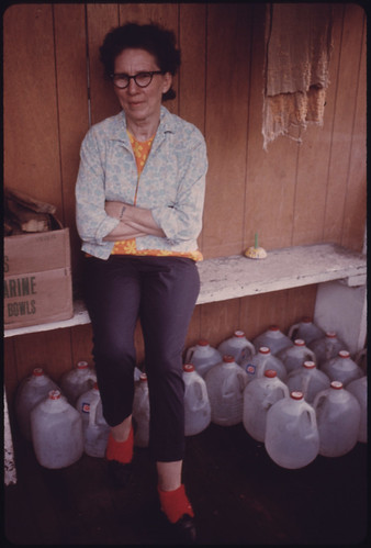 Alice Thompson, Besoco, West Virginia, Is Shown with Milk Bottles Her Neighbors Furnish Her Water with after Her Water Lines Were Cut Off. She Is Divorced From a Coal Miner Who Was Imprisoned for Killing a Man 04/1974