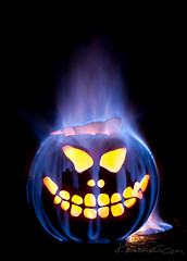 Grinning Goblin ( KristoforG) Tags: blue smile yellow headless pumpkin jack nose fire hawaii eyes head jackolantern smoke evil carving smoking creepy carve burning flame burn gourd grin annual gasoline pyro flaming fuel ooze gellert onfire diabolical horseman kristofor ooz pumpikn
