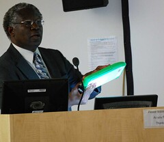 Prof. Calestous Juma with the XO-1 laptop (steps centre) Tags: africa technology growth innovation development spru