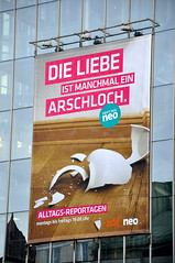 Die Liebe (a-nette) Tags: skyline munich mnchen monaco neo plakat liebe hochhaus arschloch mnchnerfreiheit spruch schwabing leopoldstrase dieliebeistmanchmaleinarschloch