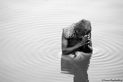 The Morning Prayer (S.R.C) Tags: bw india white black water monochrome pond nikon prayer pray ripples d200 dip bnw src blackandwhitephotography namaskar nikond200 pranam morningprayer blackwhitephotos sumanroychoudhury sumanroychoudhuryphotos sumanrc sumanroychoudhuryphotography