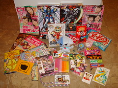 Anime USA Loot 2009 (Dreaming Magpie) Tags: city usa anime japan arlington cat magazine japanese book belt video alley kat artist comic candy crystal thing room manga games plush loot va badge revolution stuff convention figure plushie program buy pocky bento kit otaku badges goodies purchase con bought dealer purchases animeusa bulma ausa hichew kirarin