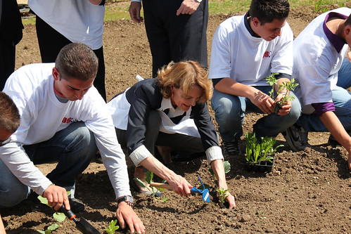 "Rose Thorne assists the students in planting seedlings in the ""Villa Taverna Orto."""