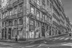 São Nicolau neighbourhood in Lisbon (Sorin Popovich) Tags: nikon d810 traveldestinations travel europe monochrome mono bw blackandwhite buildings capitalcity tram railway architecture portugal magdalena lisboa lisbon ruadaconceição