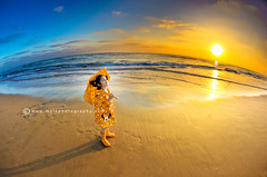 . (mylaphotography) Tags: ocean california sunset sea sky orange beach yellow golden sandiego yesterday raincoat raingear