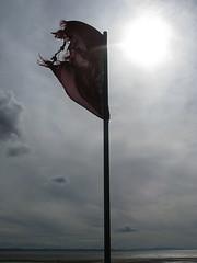 Warning flag, Crosby beach, Merseyside (MrGlen) Tags: beach windmills sculptures crosby merseyside anthonygormley anotherplace