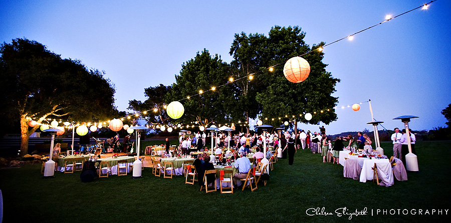 blue sky elings park godric grove wedding reception with lanterns at sunset