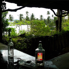 Their last drink in Lost Paradise (Bn) Tags: urban thailand dangerous topf50 decay exploring tequila palmtrees tropicalisland kohmak decrepit destroyed cottages urbex recession lavish backtonature amazingthailand lostparadise 50faves bandoned woodencottages abandonedresort lostbar tequilabottle didntworkout backtonatureresort decrepitplace lackoftourists lavishresort deathofdreams lossofprosperity naturetookitback urbanexploringinthailand urbexbar