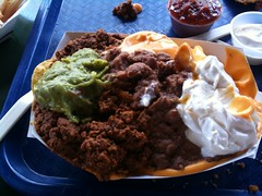 I ordered the Nachos at the Zoo and this is what the girl gave me. Holy mother of toppings! (jimrenaud) Tags: zoo massive guacamole seriously nachos heartattack iphone coalesce zoomole zoonachos