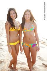 Us Girls bikini wear, Pupukea 2009 (Sean Davey Photography) Tags: color vertical seandavey finephotographyart photographersfineart bikinigirlsswimsuitfashionsurffunsurffriendsbeachphotographtropicalpicturestropicalphotostropicalphotographshappysurfbeachsceneryphotographybeachhawaiiangirlsbeachgirlshawaiianbeachgirlsusgirlsbrightcolourfulbeachfunfun