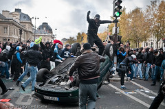 (Hughes Lglise-Bataille) Tags: money paris france car promotion riot voiture cash violence publicity 2009 argent fra distribution mailorama vandalisme meute wostok renverse