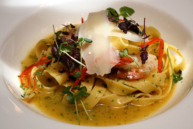 Tagliatelle with Fresh Tiger Prawns, sauteed with garlic, chillies and anchovies, topped with Parmigiano cheese shavings