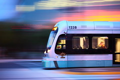 Phoenix Light Rail Sun Rise! (gbrummett) Tags: usa color sunrise wow spectacular amazing cool twilight awesome 100v10f panning phoenixarizona highiso phoenixaz 50v5f canondigitalphotoprofessional plr phoenixlightrail colourvisions photoshopcreativo canonef100400mmf455